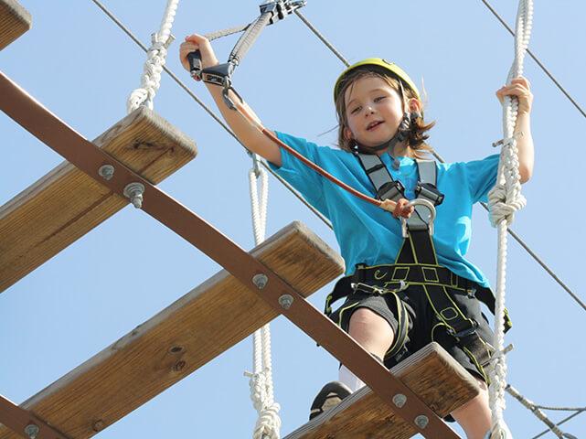 Boy climbing at Wild Blue Ropes