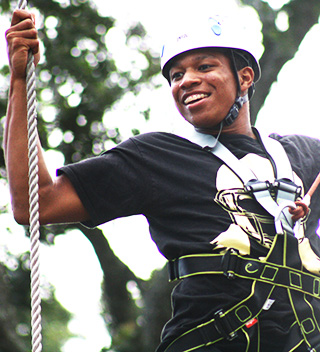 Man climbs ropes at Wild Blue Ropes